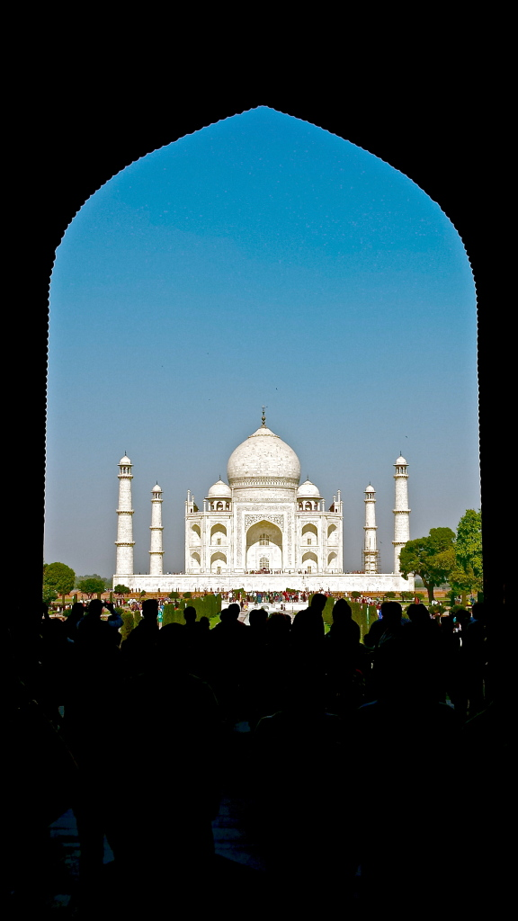 Arched gateway leading to the Taj Mahal